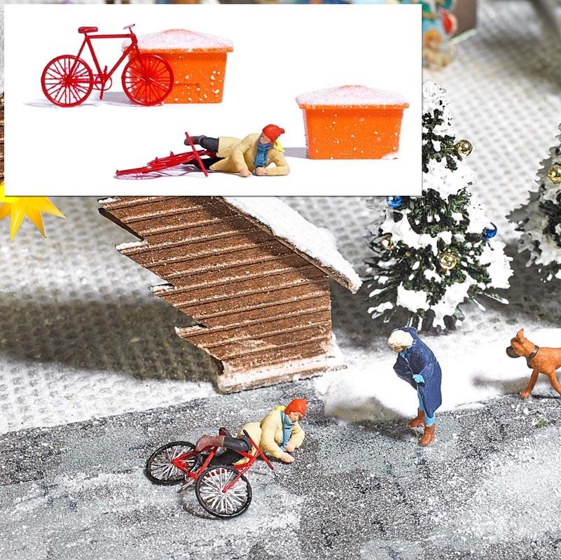Gestürzte Radfahrerin auf Eis, 1:87 / H0